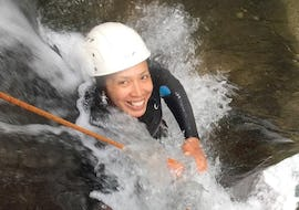 A woman is participating to the Canyoning in Canyons Grognardo and Argentina - Aquatic activity with Maglia Canyoning.