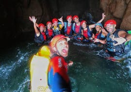 During the Canyoning at Barranco de los Cernícalos in Gran Canaria the guide of Mojo Picón Aventura takes a photo with the tour participants in the water.