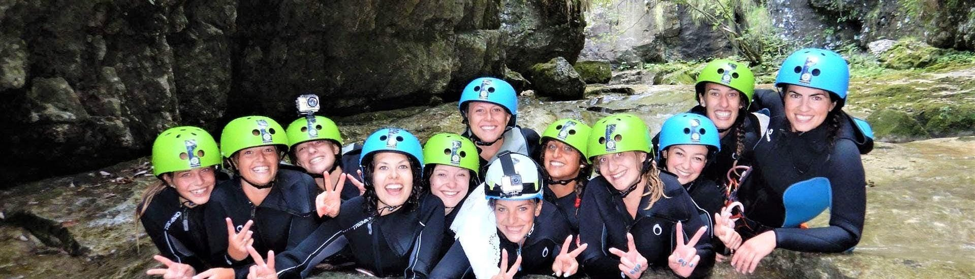 A group of friends is smiling in the canyon during the Canyoning Bachelor Party - Garda by LOLgarda.