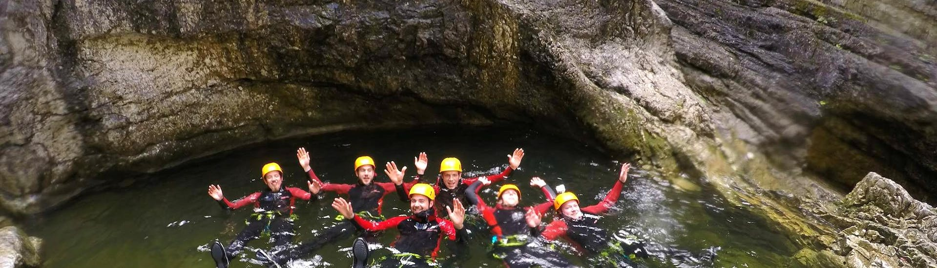 A group of men relaxing in a natural pool after celebrating their Bachelor Party with a Canyoning tour by CIA Canyoning in Austria & more Adventures.