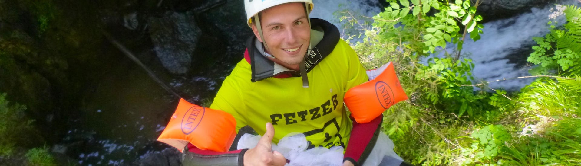 """A bachelor is dressed up with funny accessories for the Canyoning """"Stag Party"""" - Alpenrosenklamm with CanKick Ötztal."""