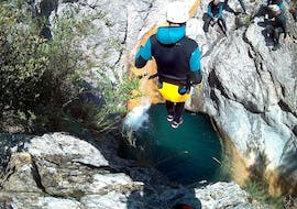 A man is jumping in the water during his Canyoning in Canyon de l'Audin - Classic activity with Maglia Canyoning.