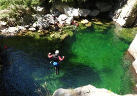 """A canyoning enthusiast is jumping in a natural pool during their Canyoning """"Day Discovery"""" - Canyon de la Haute Borne with Torrents & Granit."""