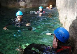 Participants of the Private Canyoning in Pulischellu - Discovery (12 ppl max) with Corsica Madness are swimming in a natural pool.