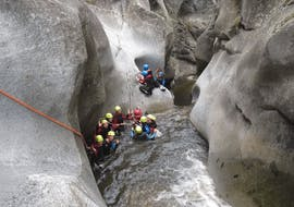 A family is having fun during their Canyoning in Canyon de Molitg Les Bains - Discovery activity with Exterieur Nature.