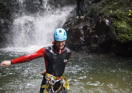 "During the Canyoning ""Epic"" in Ribeira dos Caldeirões organised by Azores Epic Adventures, a happy participant is running through a natural pool surrounded by pristine nature."