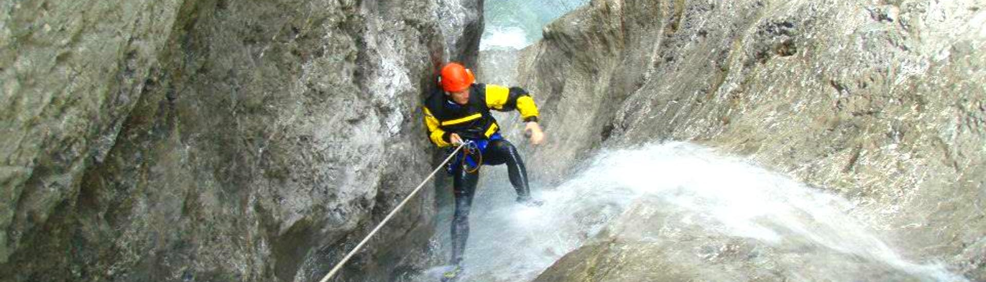 """A man abseiling down a steep canyon on his Canoying """"Extreme Tour"""" at Auerklamm with the experienced team of Natur Pur Outdoorsports."""