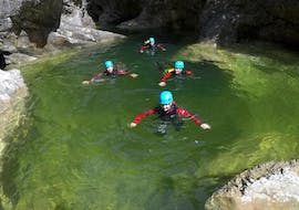 During the Canyoning for Beginners - Almbachklamm, a group of people is having fun in a canyon under the guidance of an experienced guide from Bergführer Salzburg.