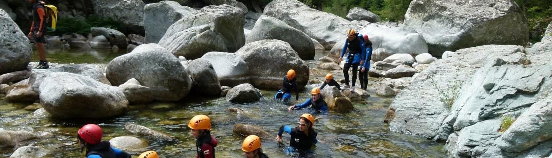 A family walks in the Canyon du Vecchio during the Canyoning activity for families with their instructor from Canyon Corse.