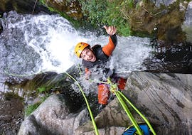 Guy is laughing while he is abseiling in a waterfall at Canyoning from Queenstown at Gibbston Valley - Half Day with Canyoning New Zealand