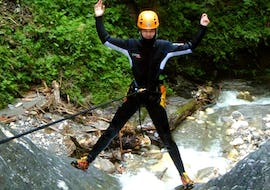 A guy has fun while abseiling during the canyoning for the Brave in the adventure canyon.