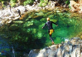 While Canyoning in Rio Frades in Arouca Geopark with Clube do Paiva, a participant jumps into the emerald green water of a natural pool.