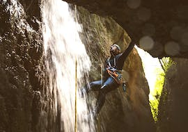 A boy faces a rope passage during Canyoning in Rio Inferno organized by Rockonda.