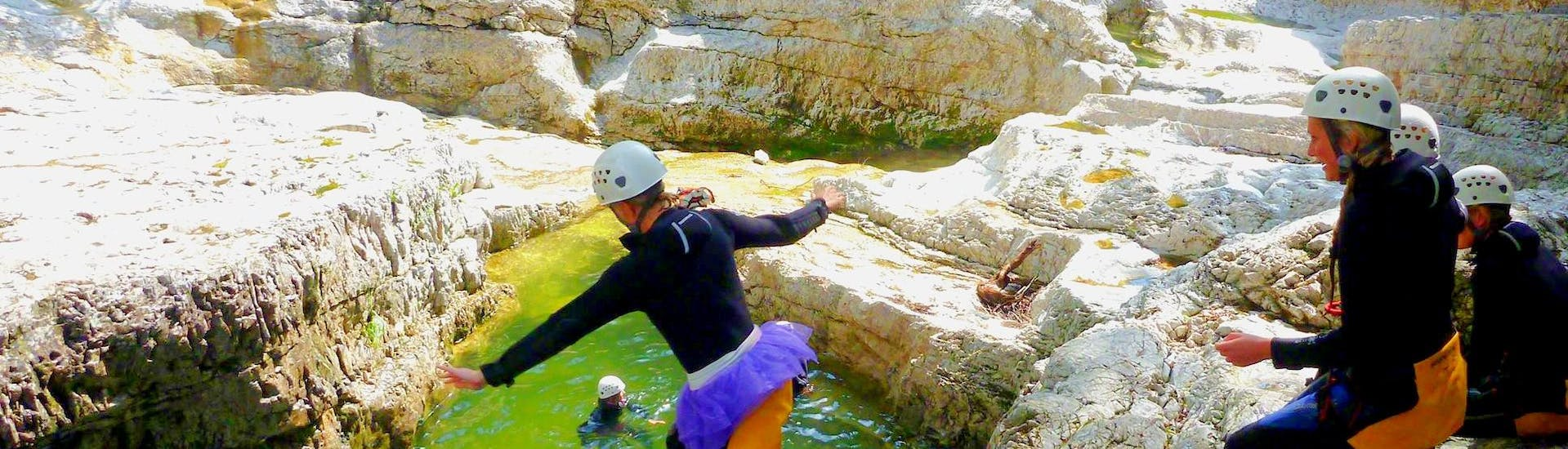 During the canyoning in the almbachklamm for bachelor parties the customers of outdoor center baumgarten is doing a big jump into the river.