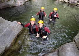 A family having fun while Canyoning in the Corippo Canyon with Ticino Adventures.
