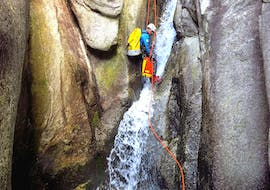 A guy abseils on a waterfall during canyoning in the Sorba with Monterosa Canyoning.