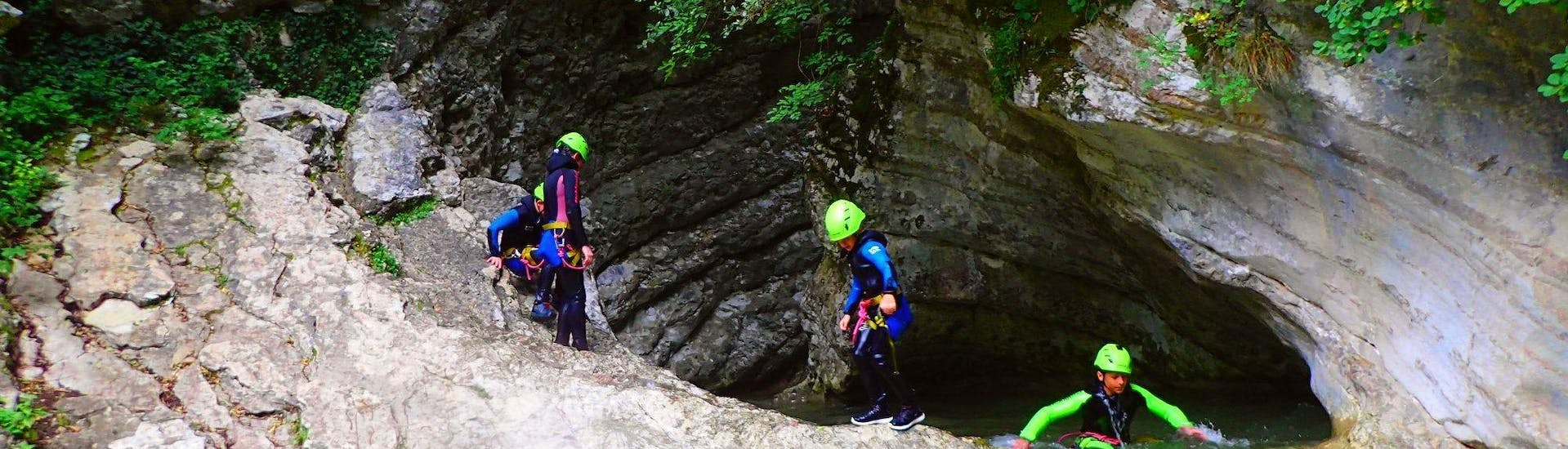 Children are doing Canyoning in the Canyoning in Torrente Vione - Gumpenfever organized by Skyclimber.