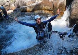 """A man is jumping during his canyoning activity """"Ludique"""" in the Canyon de la Dourbie with B&ABA Sport Nature."""