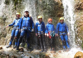"A group is posing for a photo during the Canyoning ""Redfather Short"" - Enns Valley organised by best adventure company."