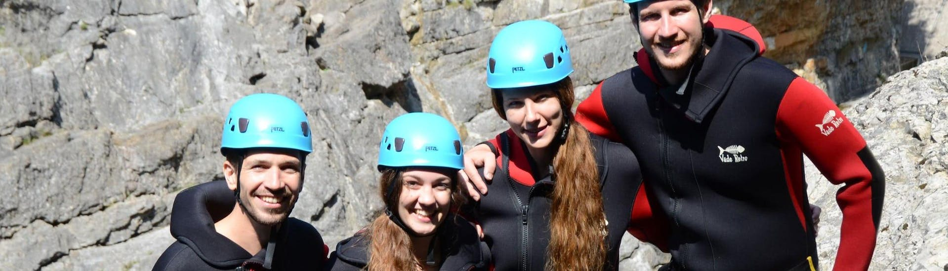"""A group of friends participating to Canyoning """"Sensation"""" - Canyon d'Angon smile during the activity."""