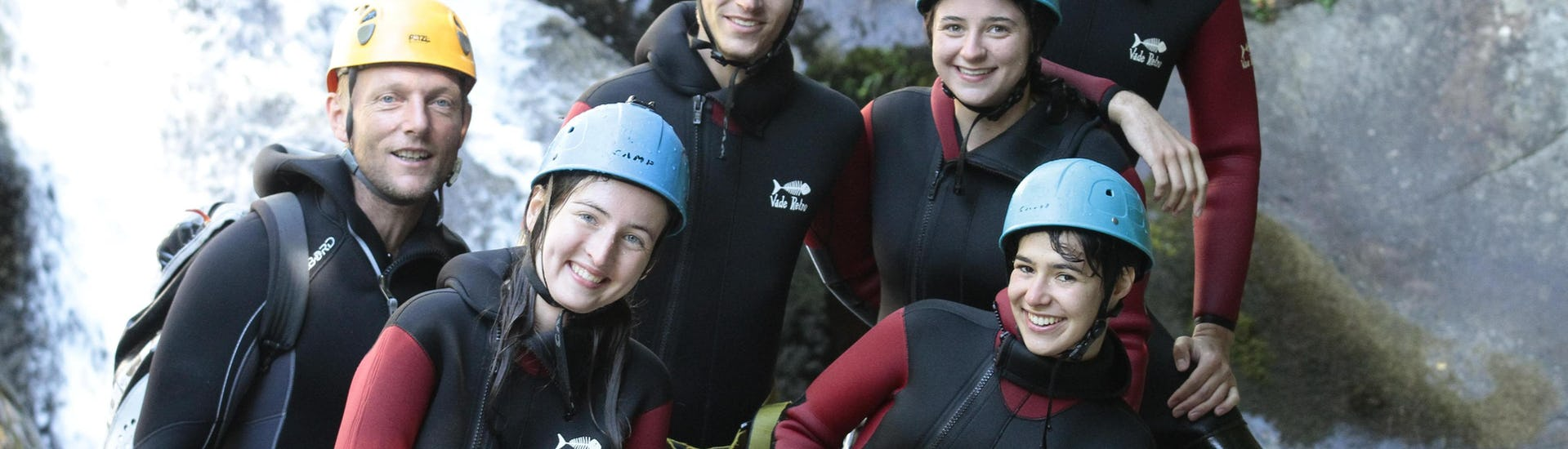 "A group of canyoning enthusiasts is taking a picture after completing their Canyoning ""Sporty Day"" - Canyon du Haut Chassezac with Les Intraterrestres."