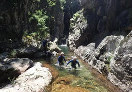 """A group of people are following their guide during their canyoning activity """"La Perle"""" at the Canyon du Tapoul with B&ABA Sport Nature."""