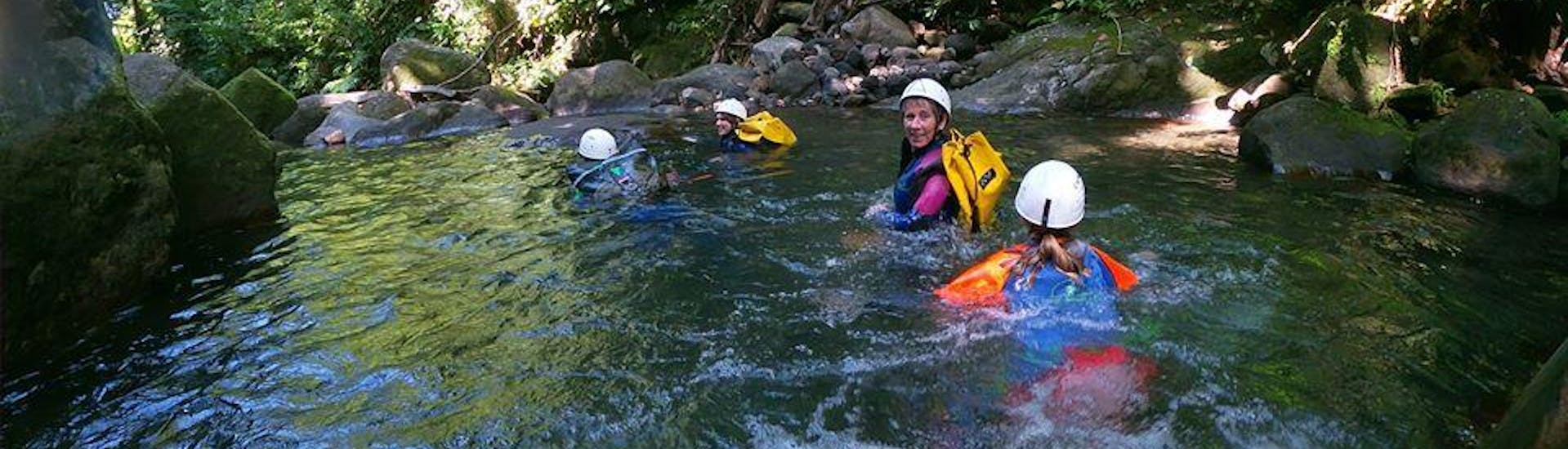 A group is enjoying the Canyoning in Ravine Chaude - Turquoise Waters activity operated by Vert Intense.