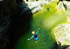 A women jumping down the canyon into the fresh mountain water as part of her day trip with Torrent Outdoor Experience.