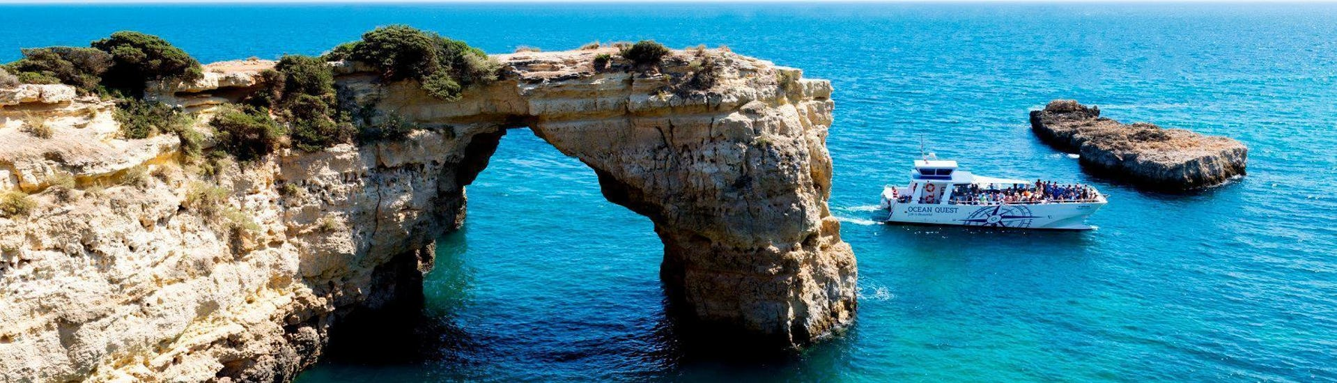 During the catamaran tour from Vilamoura heading to Caves of Benagil organised by Ocean Quest, tourists are marvelling at the stunning rock formations.