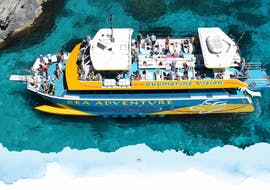 Holidaymakers are enjoying the view during their catamaran tour of the Blue Lagoon, Comino and Gozo organised by Sea Adventure Excursions.