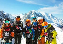 Adults smile into the camera during their Ski Lessons for Adults - 3 Day Duration (Mon-Wed) with ski school Evolution 2 Chamonix.