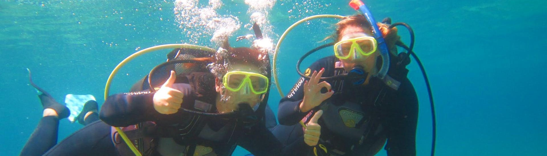 Two friends are exploring Corfu's underwater world during their CMAS* Scuba Diving Course for Beginners with Hercules Marine Activities Corfu.