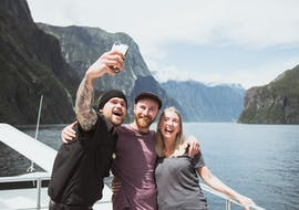 A group of friends is taking a selfie during the Coach Tour with Milford Sound Cruise - From Te Anau operated by Jucy Cruise.
