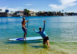 One of our guests getting accustomed to his paddle board during the stand up paddle boarding tour in Gold Coast private go vertical SUP