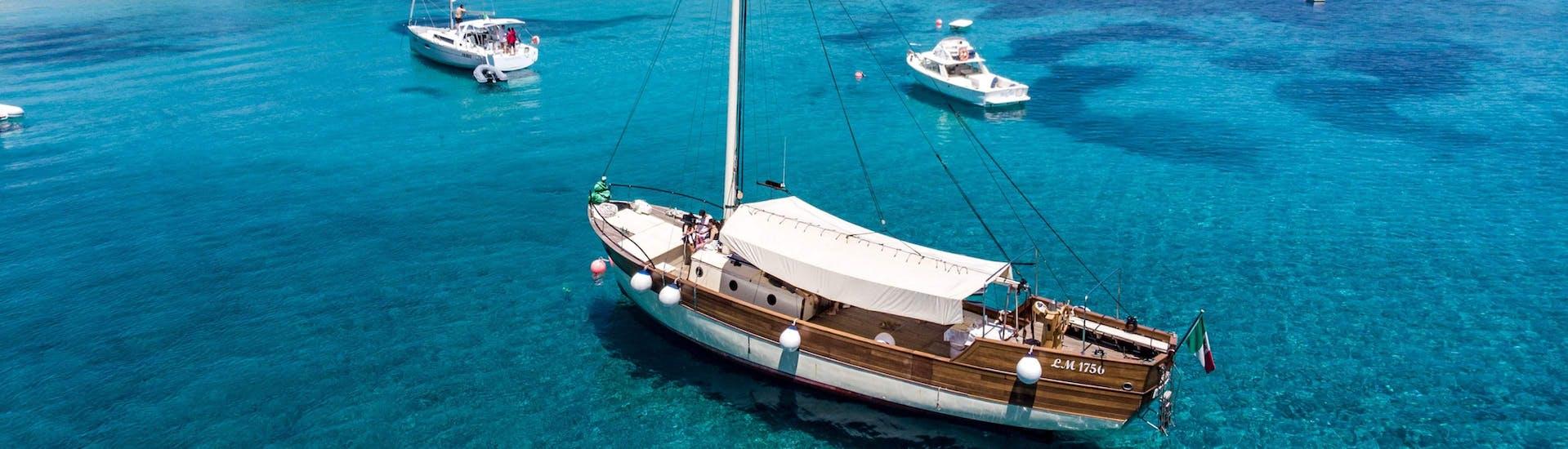 The sailing boat from Maggior Leggero Tour is anchored in the bay during the Semi-Private Sailing Boat Trip to La Maddalena Archipelago.