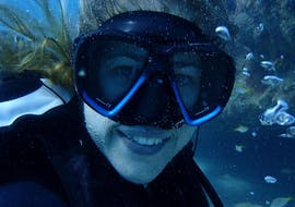 During the Discover Scuba Diving in Gold Coast - Wave Break Island, a girl is exploring the marine fauna and flora under the guidance of an experienced dive instructor from Gold Coast Dive Centre.