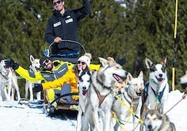 A couple enjoys the view and the sunny day during the Dog Sledding in Grand Valira with Rocroi.
