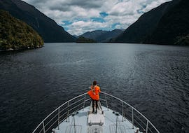 A participant of the Doubtful Sound Cruise organized by Go Orange is enjoying views from Tasman Explorer vessel