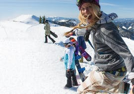 Kids Snowboarding Lessons (up to 9 y.) for Beginners with BoardStars Snowboardschule Schladming