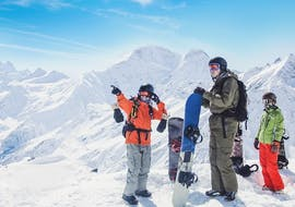 """A snowboarder points to the mountain in Private Snowboarding Lessons for Kids & Adults """"Full Day"""" with the ski school European Snowsports Chamonix."""