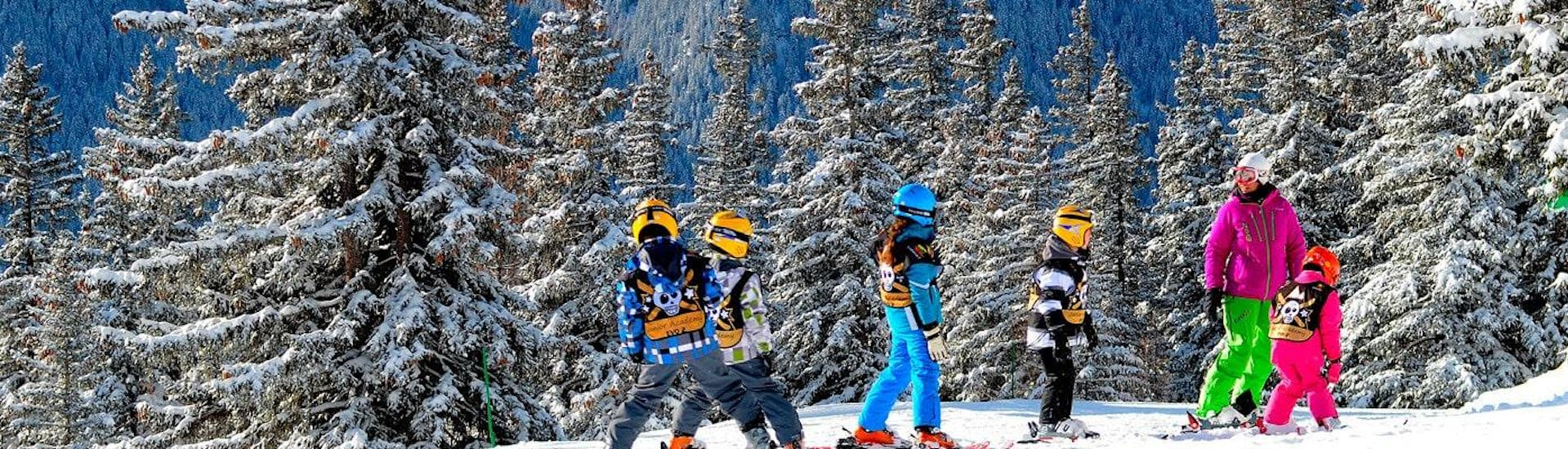 Children learn how to ski for the first time with an instructor from the ski school Evolution 2 Val d'Isère located in the ski resort Val d'Isère.