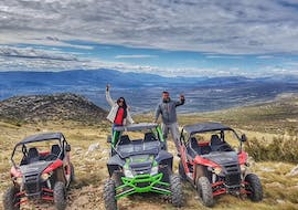 Two participants of Cetina River Extreme Buggy Tour from Sinj organised by Hotel Alkar, a couple is taking a picture with stunning Dalmatian landscape.