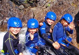 Four young kids are having fun during the Family Canyoning in the Lechtal Valley organized by Fun Rafting Lechtal.