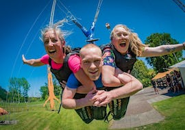 Having purchased a Family Package with 6, 8 or 10 Rides in Rotorua, a family is enjoying together one of the adventurous activities that Velocity Valley Rotorua Adventure Park offers.