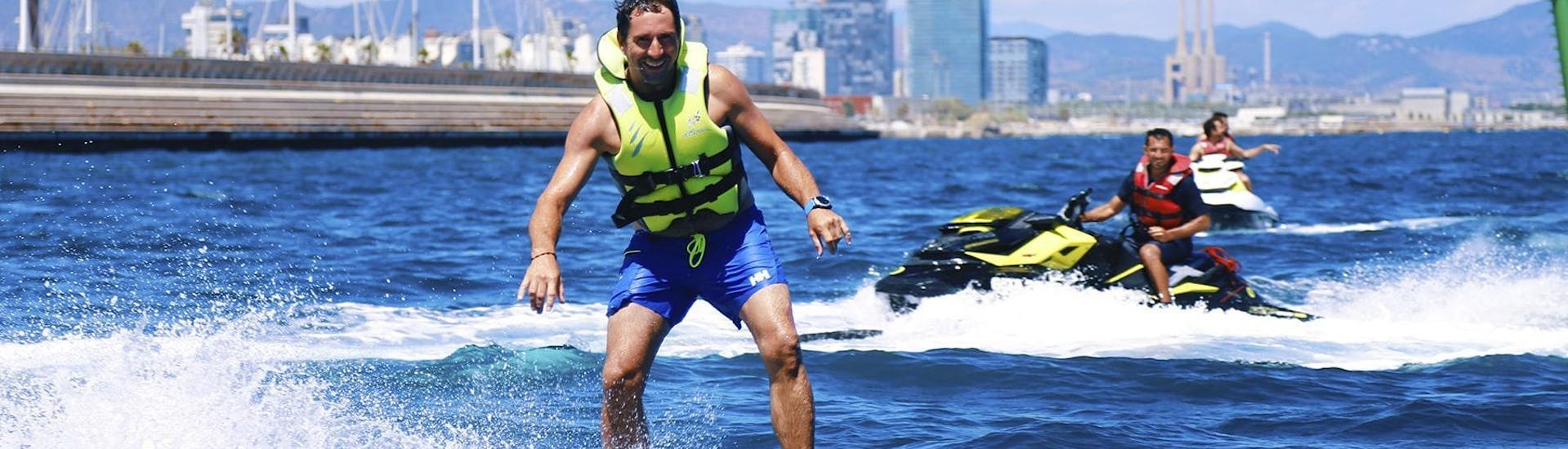 A Man is mastering the Flyboarding & Hoverboarding - Barcelona under the supervision of an experienced instructor from Five Star Barcelona.