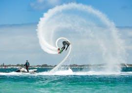 A person goes flyboarding in Daphnila Beach with Corfu Ski Club.