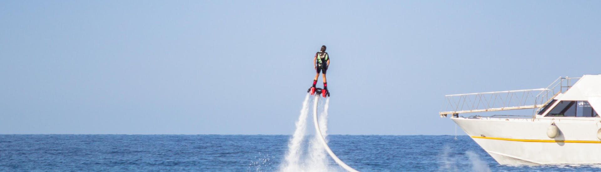 Man flyboarding on the ocean
