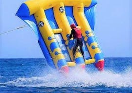A guy is riding the flyfish in Benidorm during the activity organized by Carlos Water Sports Benidorm.