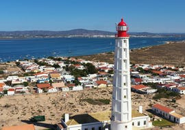 Beautiful Lighthouse in Olhão that you can see during the 3 Islands Boat Trip through the Ria Formosa Natural Park  with Odyssey Tours.