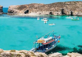 During the Full-Day Cruise to Blue Lagoon, Comino & St. Paul's Islands with Mermaid Cruises Malta, the boat is anchored in the Blue Lagoon while the passengers are swimming, snorkeling & exploring the island of Comino.